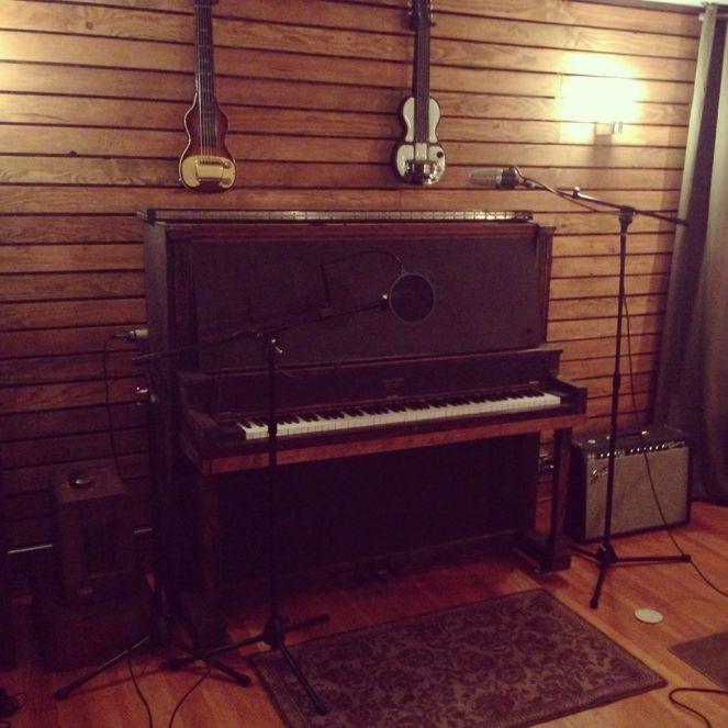 February 2013: We installed hardwood flooring and stained, wooden slats on the walls of the live room.
