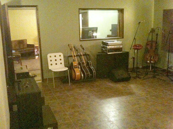 Temporary vinyl floor squares in the live room.
