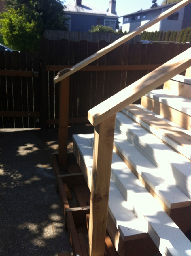 rock and nest porch remodel railing 1