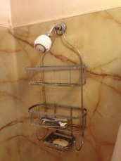 before showerhead with shampoo soap holder rockandnest