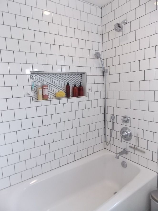finished bath shower white tile gray grout rock and nest 1