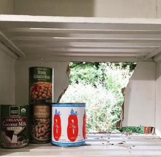 Kitchen cabinet with a view: A large hole was accidently punched through the house.